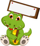 Cute crocodile cartoon holding blank board Royalty Free Stock Images