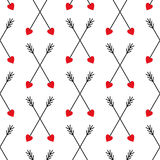 Cute crossing arrows background for Valentine's Day. Cupid's arrows seamless pattern. Cute crossing arrows background for Valentine's Day. Abstract arrows with Stock Photo