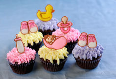 Cute cupcakes for a baby shower or christening royalty free stock image