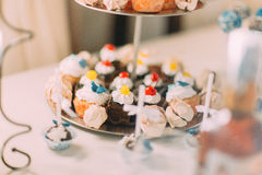 Cute cupcakes on tier at wedding reception.  Stock Photography