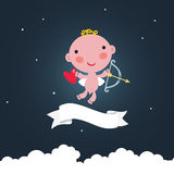 Cute cupid in the dark sky. Royalty Free Stock Photos