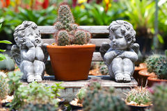 Cute Cupid statue in the garden. Royalty Free Stock Photos