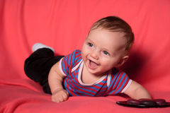 Cute curiose  baby. One very  cute  foor mounts old baby croweling Royalty Free Stock Photo