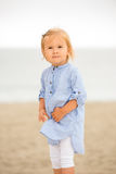Cute curious little girl at the beach Royalty Free Stock Image