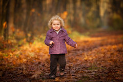 Cute curly baby running leafs Royalty Free Stock Photo