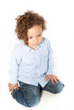 Cute Curly Blond Male Kid Kneeling Down Royalty Free Stock Images