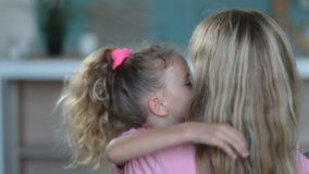 Cute daughter embracing mother with love at home stock video footage