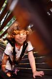 Cute curly child in a rope park Stock Image