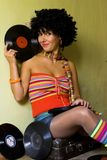 Cute curly disco girl. With vinyl royalty free stock photo
