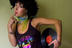 Cute curly disco girl. Cute curly deejay girl with vinyl royalty free stock photography