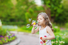 Cute curly girl  with  soap bubbles Stock Photos