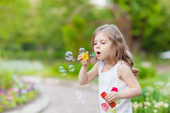 Cute curly girl  with  soap bubbles Stock Photography