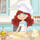 Cute curly hair girl baking cookies Royalty Free Stock Photos