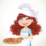 Cute curly hair girl chef offers a taste of pizza Stock Images