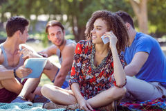 Cute curly hair girl on the phone in the park Stock Images