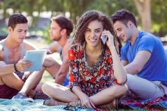 Cute curly hair girl on the phone in the park Royalty Free Stock Photos