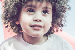 Cute curly hair kid Stock Images
