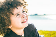 Cute curly hair kid Royalty Free Stock Photos