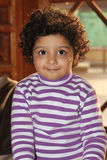Cute curly hair light skin south asian boy Stock Photography