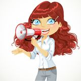 Cute curly haired girl speaks in a megaphone Stock Photos