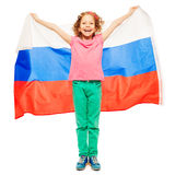 Cute curly-haired girl waving a Russian flag Stock Images