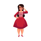 Cute curvy, overweight girl in glasses and fashionable red dress Stock Photo