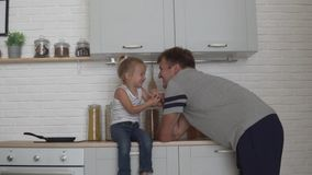 Cute dad and daughter hugging in the morning in the kitchen.  stock video