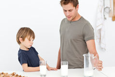Cute dad and son drinking milk Royalty Free Stock Photos