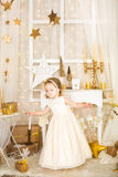 Cute dancing girl in gold decorations Royalty Free Stock Photos