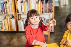 Free Cute Dark-eyed Girl With Down Syndrome Taking Her Glasses Off Royalty Free Stock Photos - 133014778