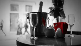 Cute dating black and white scene. Champagne in bucket with glasses. Stock Photo