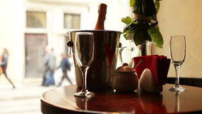 Cute dating scene. Champagne in bucket with glasses. stock video footage