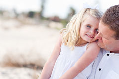 Cute Daughter Cuddles up with Her at the Beach Stock Image