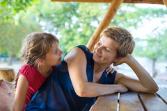 Cute daughter embrace with her beloved mom Royalty Free Stock Photo