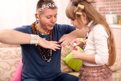 Cute daughter and her father having princess time Royalty Free Stock Photos