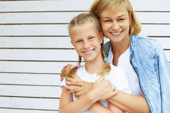 Cute daughter with her mother. Family time Royalty Free Stock Photography