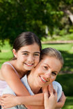 Cute daughter with her mother in the park Royalty Free Stock Image