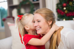 Cute daughter and mother celebrating christmas Stock Images