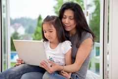 Cute daughter and mother with laptop Royalty Free Stock Image