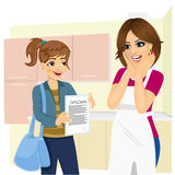 Cute daughter showing school diploma to happy mother Stock Photo