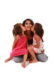 Cute Daughters Kissing Their Mom Stock Photo