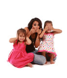 Cute daughters and mom Stock Images