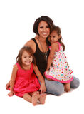 Cute daughters and mom. Daughters and mom on white background