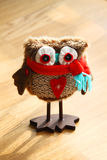Cute decorative owl toy with winter scarf. Here is a cute and funny decorative owl toy, with big eyes, a winter scarf on her neck and a heart in the middle, just Stock Photo
