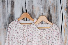 Cute designer nightgowns. On rustic background. Soft cotton, ruffles and flowers. Limited collection, sale Stock Photo