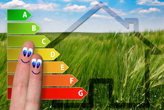 Cute diagram of house energy efficiency rating with two cute happy fingers and green background. Very cute diagram of house energy efficiency rating with two Stock Photography