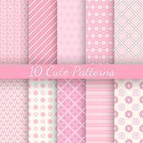 10 Cute different vector seamless patterns. Pink. And white colors Royalty Free Stock Photography