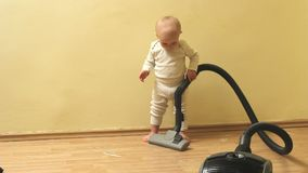 Cute and diligent baby boy clean the house with vacuum cleaner. Cute and diligent funny baby cleans the house with vacuum cleaner, Full HD stock footage