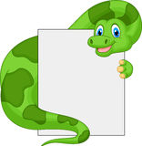Cute dinosaur cartoon holding blank sign Royalty Free Stock Photography