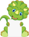 Cute dinosaur cartoon holding blank sign Royalty Free Stock Images